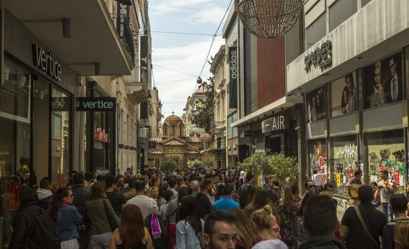 ATHENS, GREECE - MAY 10, 2014: Athenians and tourists in center of city. Tourism is a decisive sector of hope for Greek economy - In the year Greece receives about 18 million tourists.