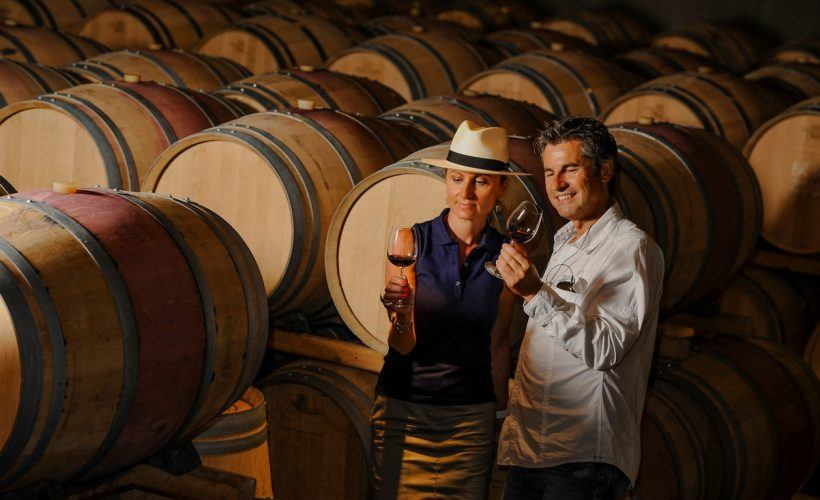Tourism – Couple tasting wine in a cellar